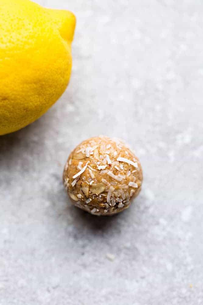 Lemon energy bite paired with a lemon