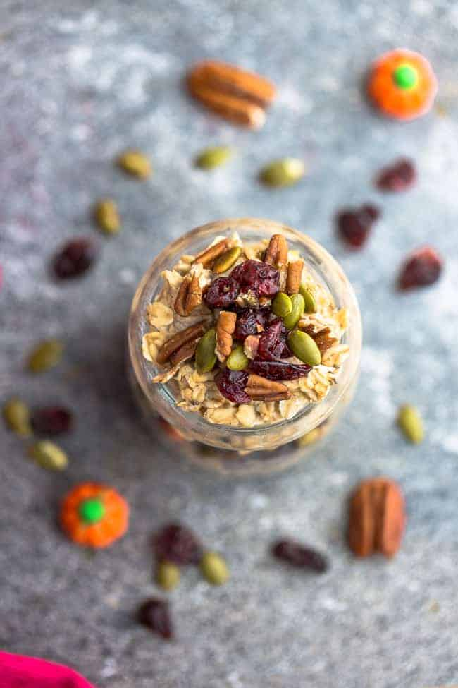 overhead image of pumpkin overnight oats recipe with seeds and raisins