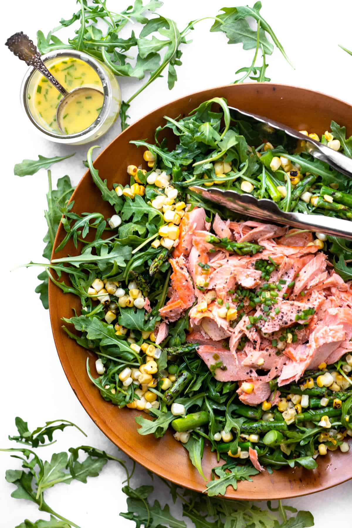 Overhead view of Blistered Corn and Arugula salad with salmon
