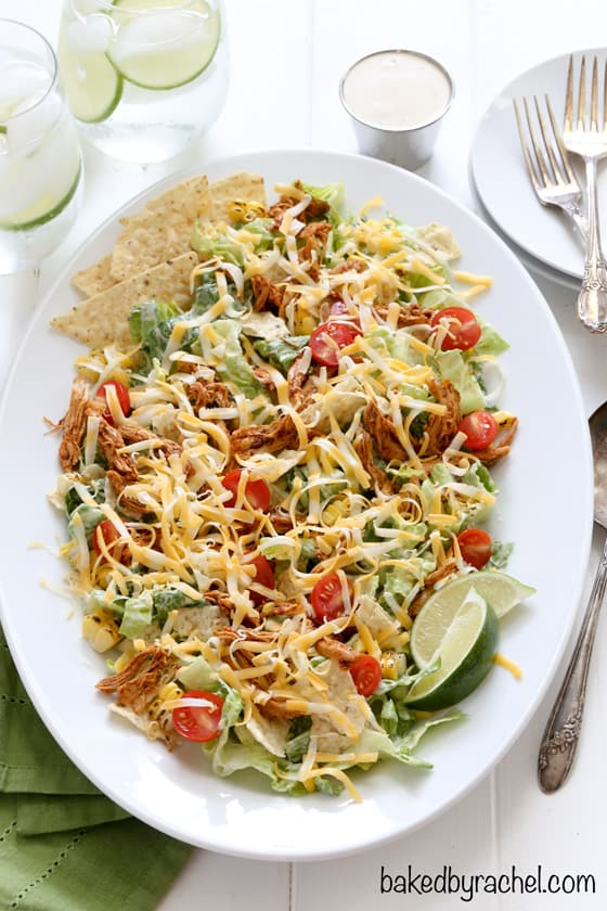 Overhead view of Chicken Enchilada Salad topped with shredded cheese