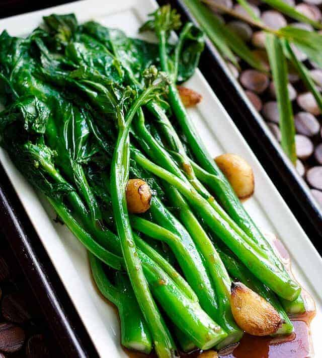 Chinese Broccoli with Oyster Sauce on a rectangular plate