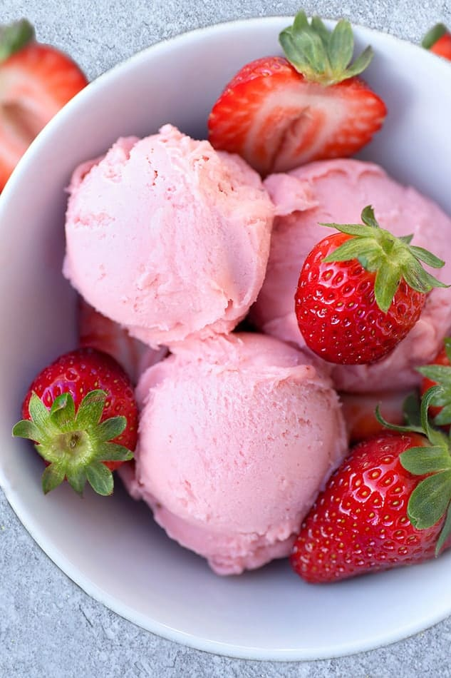 Easy no churn strawberry ice cream as an eggless dessert.