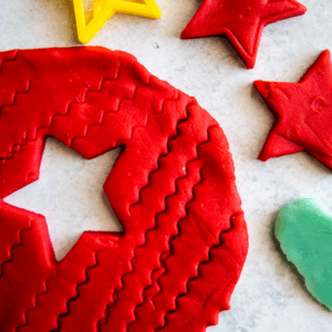 red and blue homemade playdough without cream of tartarcut out in stars