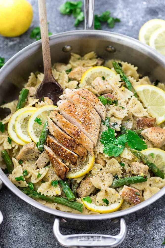 lemon chicken asparagus pasta in pan with lemon and herbs