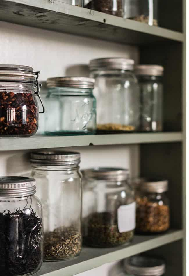 mason jars filled with pantry staples on shelves