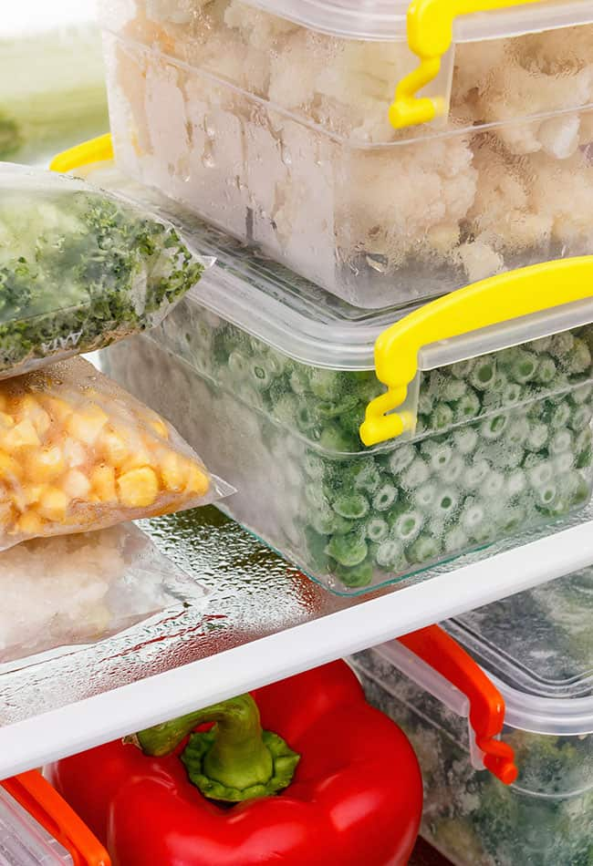 image of food in freezer such as peas and red bell pepper