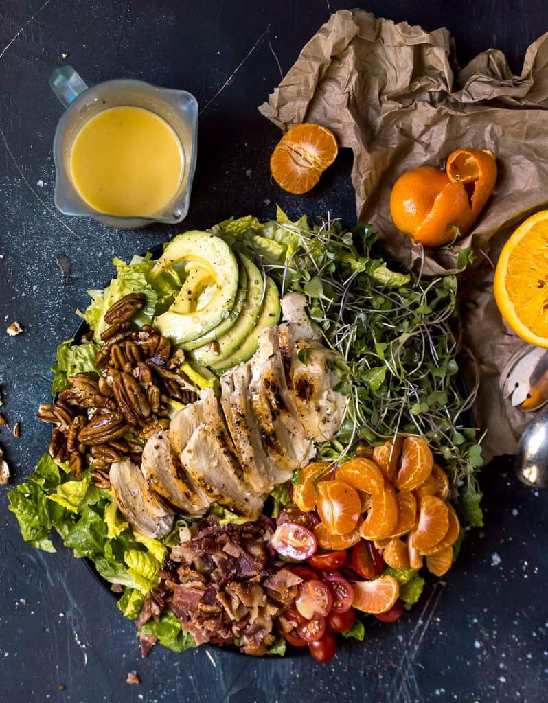 Overhead view of a bowl of Bacon Chicken Salad with mandarin oranges and avocado