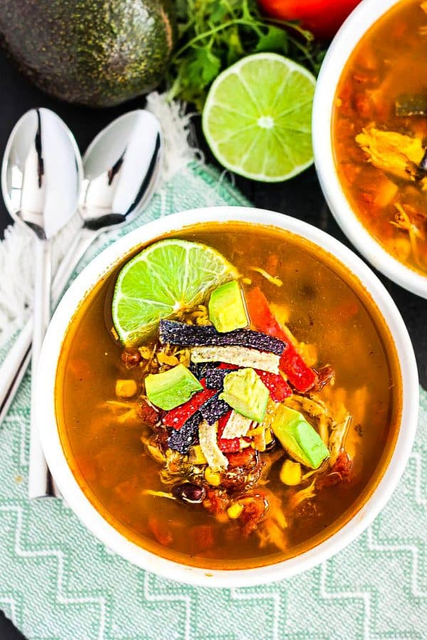 Overhead view of two bowls of Slow Cooker Chicken Tortilla Soup